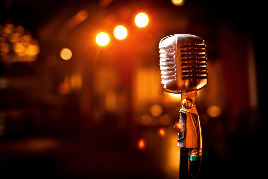 Retro microphone on stage in restaurant. Blurred background