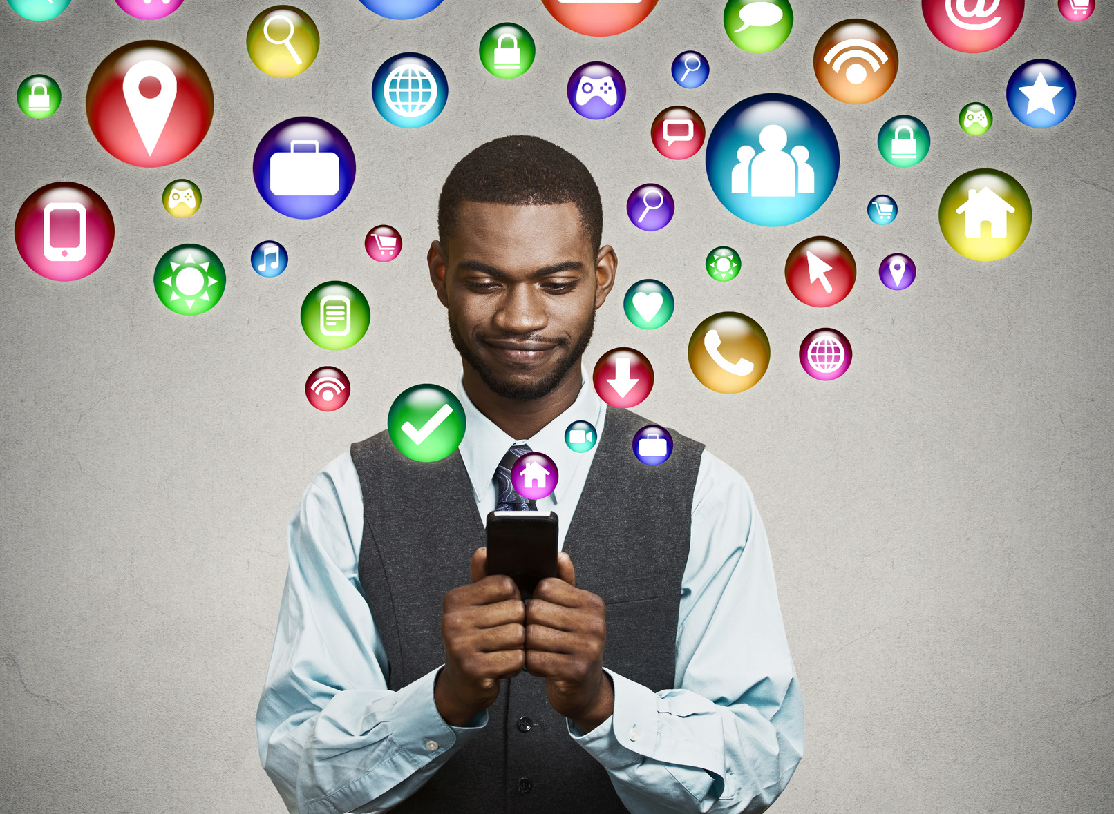 communication technology mobile phone high tech concept. business man using texting on smartphone social media application icons flying out of cellphone isolated grey wall background. 4g data plan