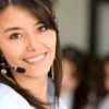 beautiful business customer service woman - smiling in an office